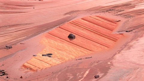 Medium-shot of rock and sand formations on the desert... Stock Video Footage