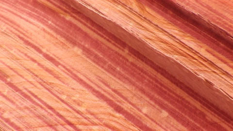 Pan-right across the layers of orange sandstone on a... Stock Video Footage