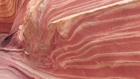 Pan-left of the layers of orange sandstone on a desert... Stock Video Footage