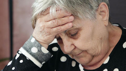 sick grandmother touches her fevered brow Footage