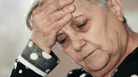 old woman suffering from a headache Live Action