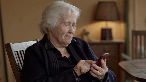 Old lady texts a message on the mobile Footage