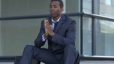 upset and sad businessman: African american businessman worried on the steps Live Action