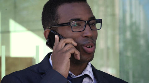 smiling young black businessman he is smiling and talking on the phone Footage