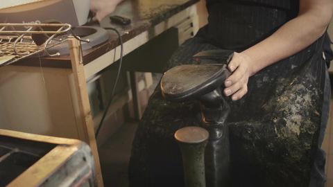 Shoemaker repairs heel Footage