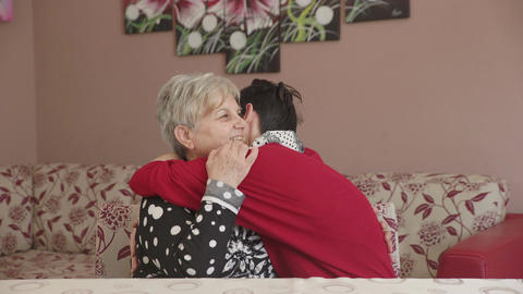 big hug between grandmother and her grand-daughter Footage