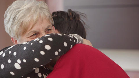 Strong hug between grandmother and her grandaughter Footage