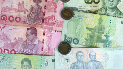 Close-up zoom in on Thai baht money Live Action