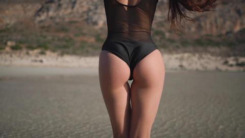 Bikini butt model infront of a beach Live Action
