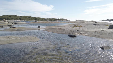 Scenic dreamlike view of west coast smooth shoreline rock, Bohuslan, Sweden, Pan Live Action
