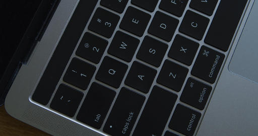 fly over gray modern Laptop Keyboard close-up Live Action