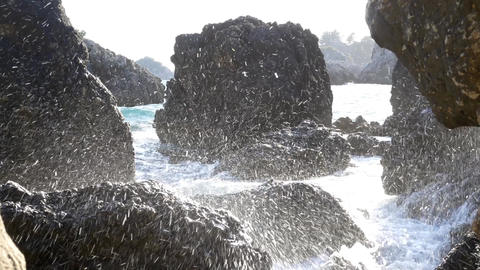 Splashes of water formed when waves break on the shore of steep boulders 80 Footage