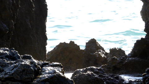 Splashes of water formed when waves break on the shore of steep boulders 81a Footage