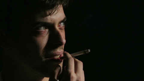 desperate man smoking: depression, fear, sadness, loneliness, dark Footage