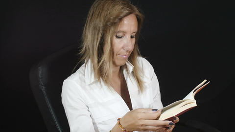 woman reading a book: novel, reading, culture, entertainment Footage