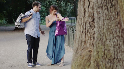 romantic young lovers playing with hats during a walk in the park Footage