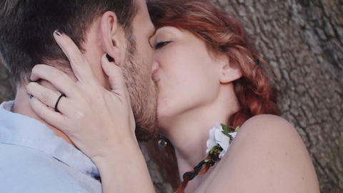 couple in love kissing near a tree: park, love, sex,... Stock Video Footage