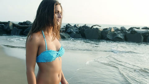 beautiful woman on the sea shore in a summer day Footage
