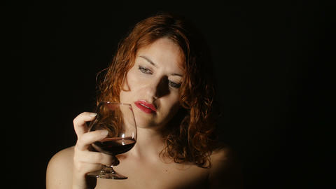 woman addicted by the wine is drinking in the darkness: depression, pain, diseas Footage