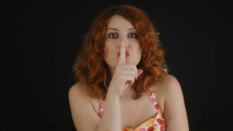 do silence: young woman indicate silence with finger over her lips Footage