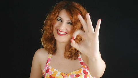 young woman makes approval gesture: ok sign, positive, affirmative Footage