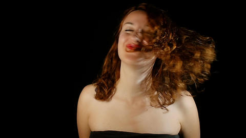 Beautiful woman shakes her hairs Footage