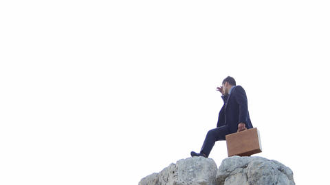 tired businessman on the top of a mountain is searching for something: seeking Footage