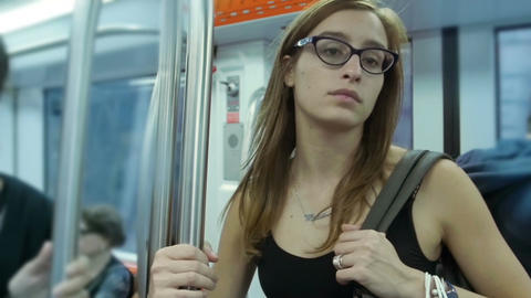 Blonde caucasian lady traveling by public transport. Lonely in the crowd Footage