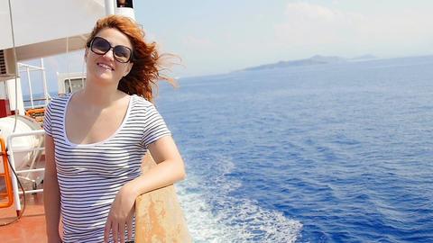 thoughtful woman on board of a ship: summer, sun, wind, pensive girl Footage