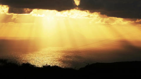 sunlight throw the clouds in yellow sunset on the sea: Sicily, Italy, summer Footage