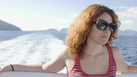 thoughtful woman on a ship: sea, summer, summertime, sun Footage