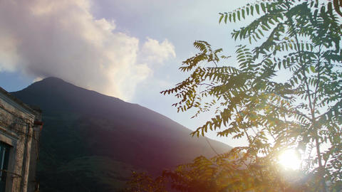 Vulcano island landscape: sun through the leaves of a tree: volcano background Footage