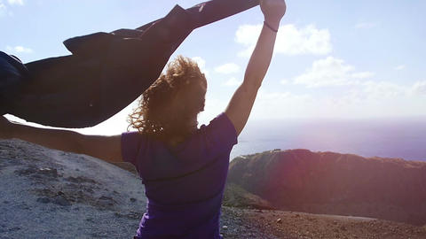 peaceful and happy woman with raised arms in the wind: freedom, summer Footage