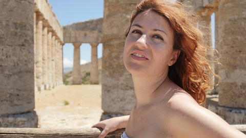 young beautiful woman admiring monuments in Sicily: Valley of the Temples, Italy Footage