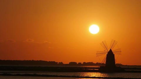 windmill near salt pans on Trapani in sicily: Italy, timelapse Footage