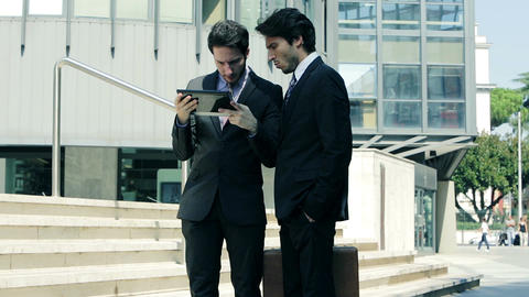 working in the financial district: business people at work with mobile devices Footage
