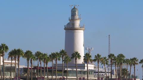 Malaga Lighthouse view, La Farola, Malagueta beach, Andalusia, Spain Live Action