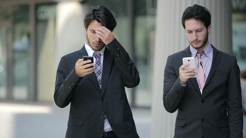 formal business people going to work and using smartphones Footage