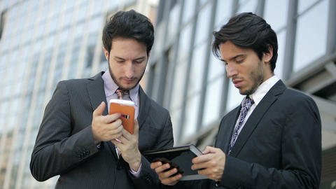 business people using smartphone and tablet computer near office: team work ビデオ