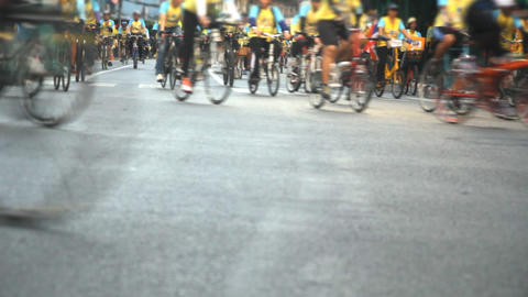 Group of cyclists on street Live Action