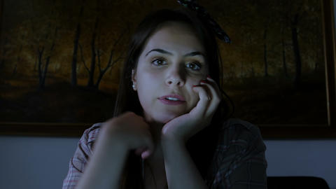 young woman talking with someone late in the night using a webcam Live Action
