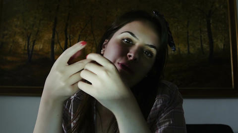 very young woman chatting in the night using the webcam: perspective from webcam Live Action
