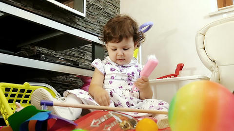 baby playing with her toys: little girl in the living room Footage