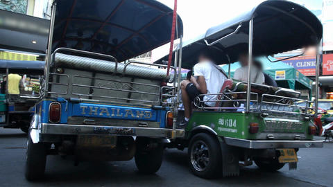 Foreign tourists taking Tuk Tuk in Bangkok , Thailand Footage