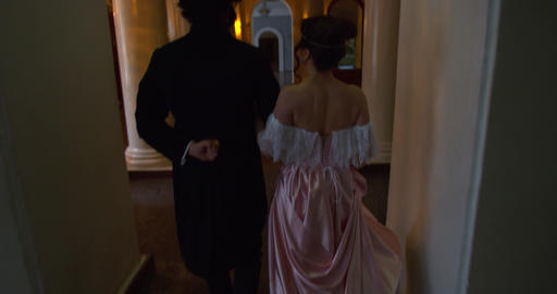 Beautiful 18th century couple is walking in a beautiful palace in the evening 4k Live Action