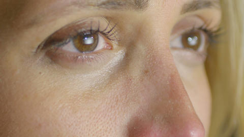 sad woman crying: very closeup portrait on her eyes: sadness, depression, alone Live Action