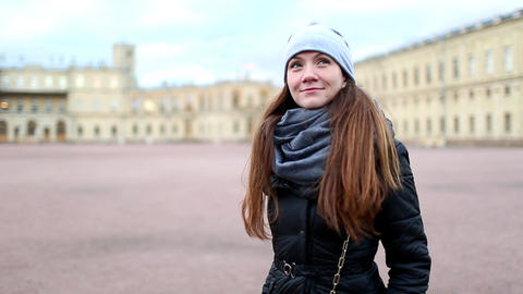 Woman look around old Gatchina Palace square, inquisitive tourist girl portrait Footage