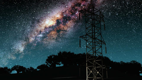 Electricity pylons and lines. Milky Way stars at night Animation