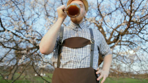 Stylish young man posing at the camera with a glass of beer GIF
