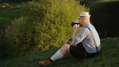 Bavarian sitting on a hill near the cliff GIF